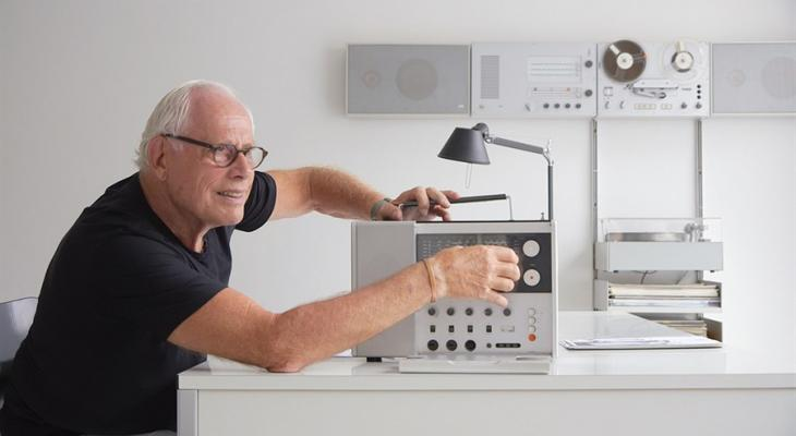 Dieter Rams siting at a desk