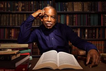 LeVar Burton in a library with an open book