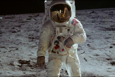 Person in spacesuit walking on the moon