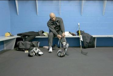 Person putting on hockey skates