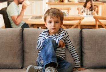 child sitting on couch